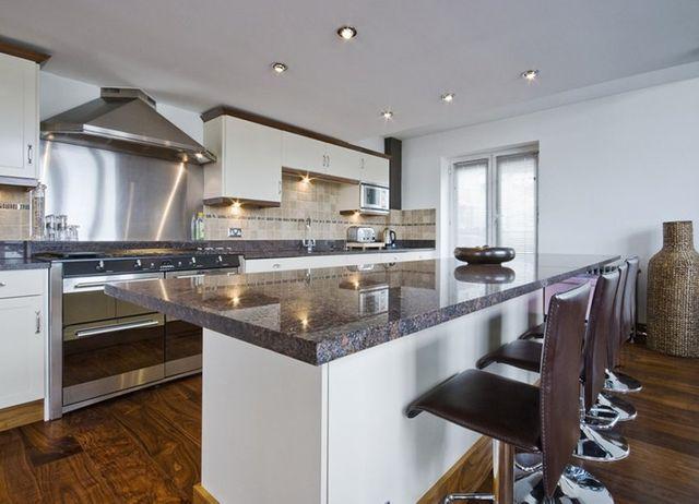 modern kitchen in white with wooden floor