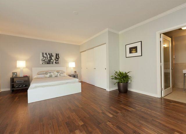 spacious wooden floored bedroom