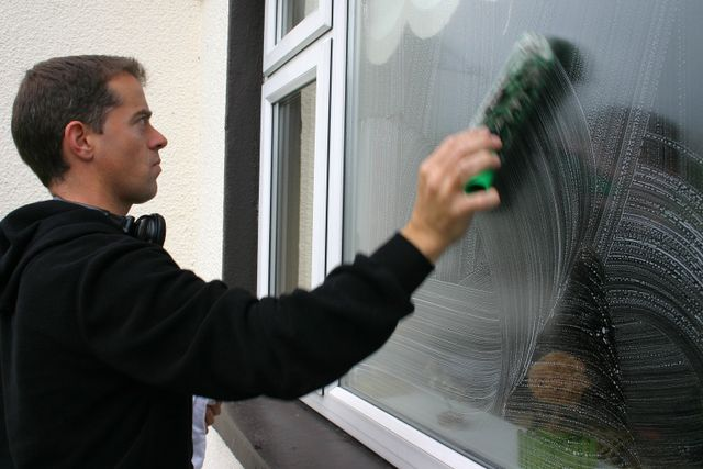 cleaning a window exterior