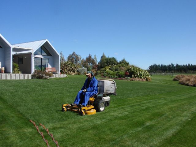 Man on a ride on mower