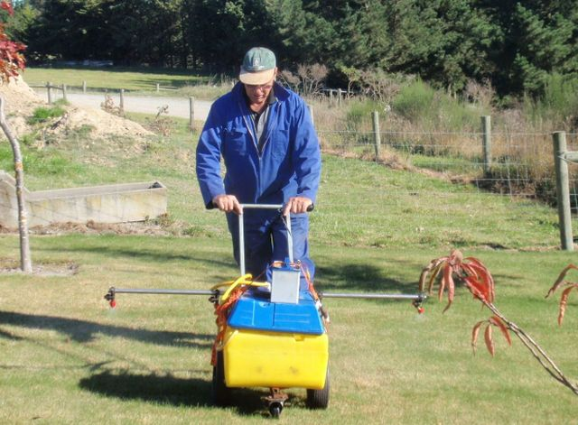 Man pushing mower