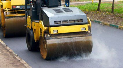A roller being used on a new road surface