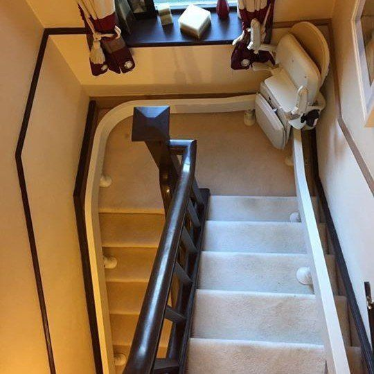 Helping Hand Stairlifts supply and fit curved stairlifts. Stairs with a bend, spiral stairs