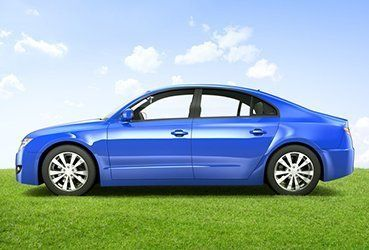 A blue car parked on a lawn