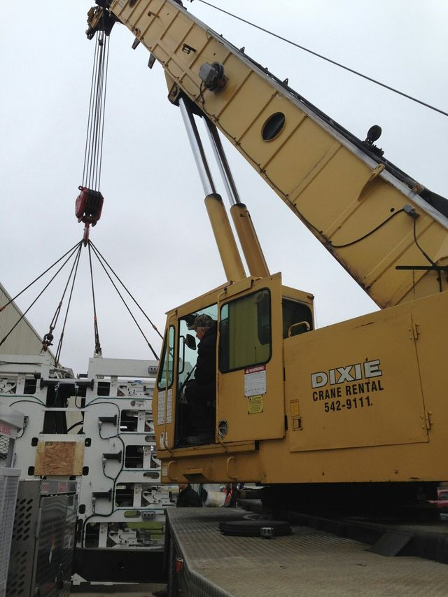 Crane operators working in a construction area in Cincinnati, OH.