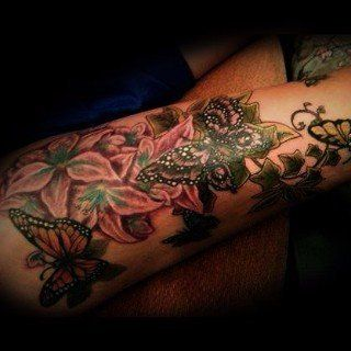 Butterfly on a flower tattoo