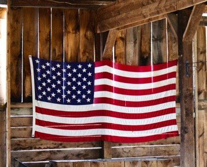American Flag hanging in barn