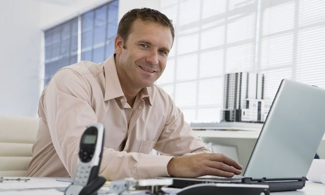 Smiling man on a computer