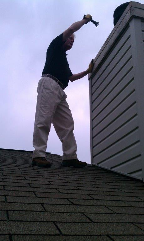 One of our home inspectors in Cincinnati, OH, checking out a chimney