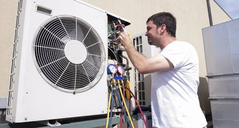 air conditioning engineer at work