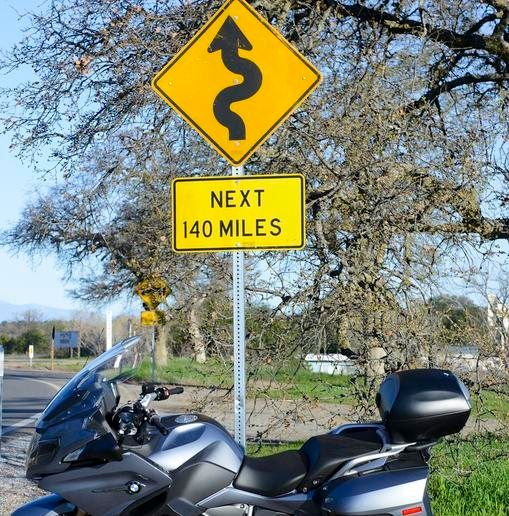 A rented motorcycle in San Francisco near a road sign