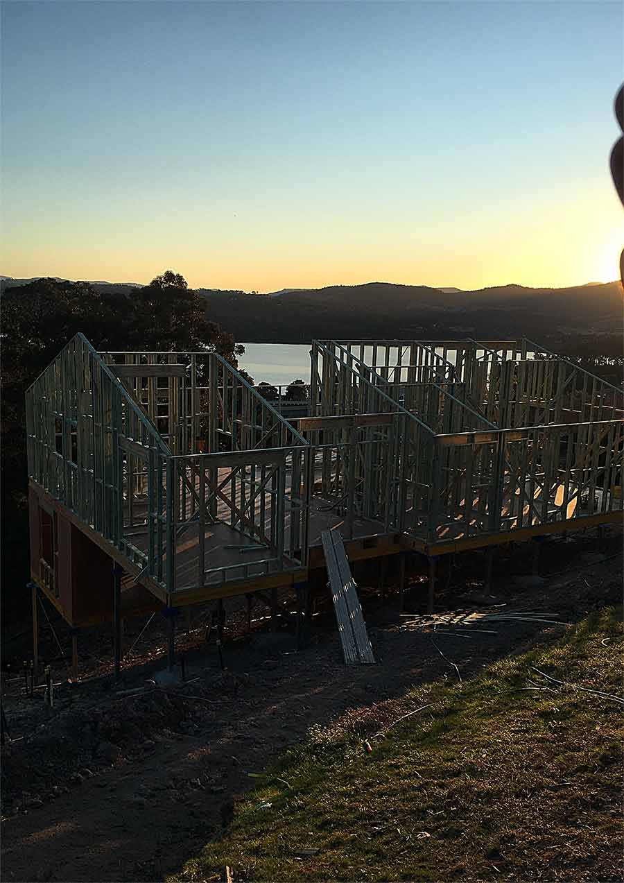 house construction with sunset