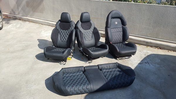 four black car seats
