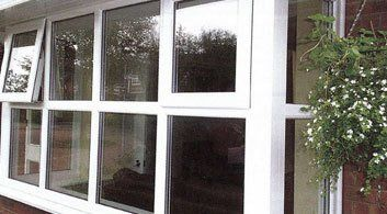 Exterior view of double glazed windows with pushout window open