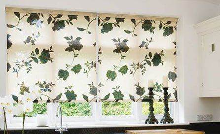 Cream roller blind with green leaf pattern