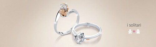due anelli argentati e la scritta i solitari