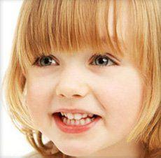 Denplan Care scheme - Ferndown, Dorset - Nigel Stribling & Associates - Smiling Little Girl