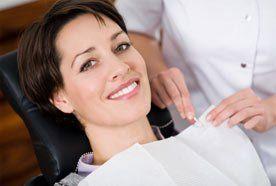 A dental nurse pinning a protective