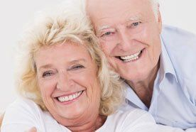 A smiling mature couple with healthy-looking teeth
