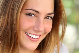 A smiling young lady with white teeth