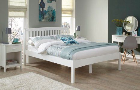 White wooden beds