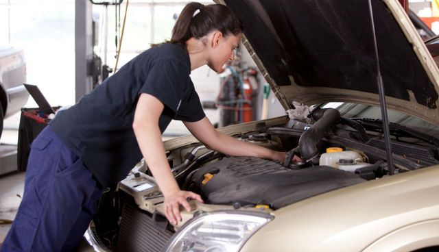 Auto servicing technician working on vehicle tune ups in Hinesville, GA