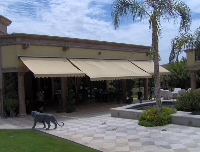 Exceptional Multiple Motorized Retractable Awnings On Custom Home
