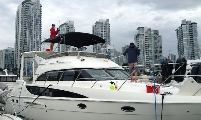 Washing the exterior of Yacht