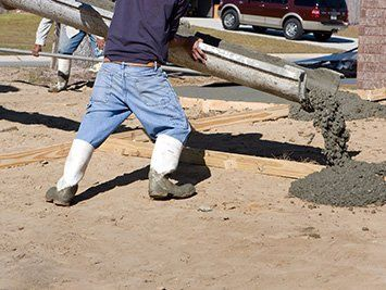 Fresh concrete being poured at the construction site