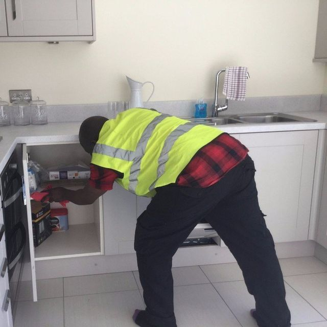 cleaner wearing safety jacket