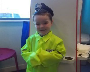 baby dressed as policeman