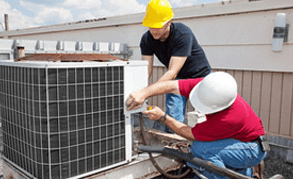 Men working on industrial air conditioning