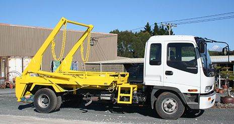 Just rubbish yellow skip pick up truck