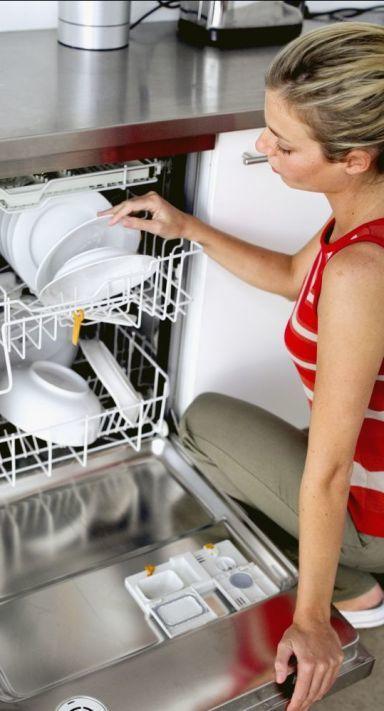 woman loading her dishwasher after it's appliance repair in Blenheim
