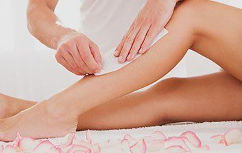 Woman having waxing done