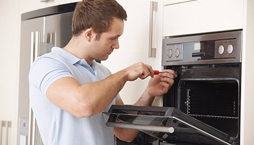 Trusted professional doing the repair of an appliance in Lake Havasu City, AZ