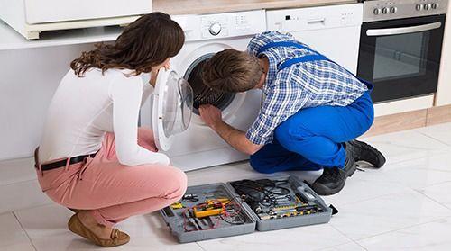 Expert repairing a washing machine in Lake Havasu City, AZ