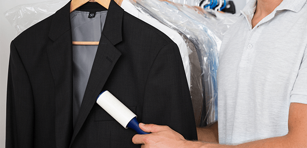 Military dry cleaning — Person Hand Removing Dust With Lint Roller in  Buffalo 2a06df9c5