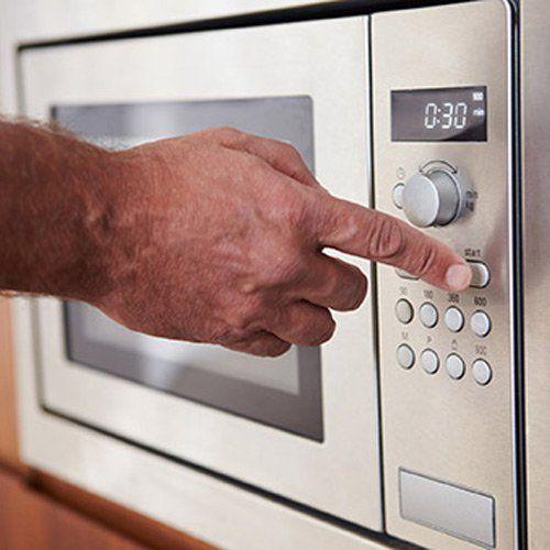 Home Appliance Repair — Man Using Microwave in Bountiful, UT