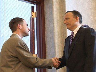 Thomas A. Corletta shaking the hand of a client