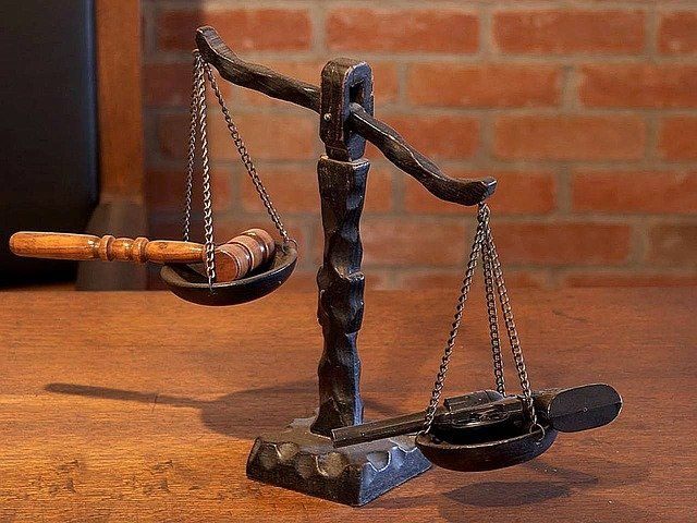 A gavel and legal scale