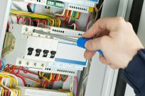 Electrician completing wiring work