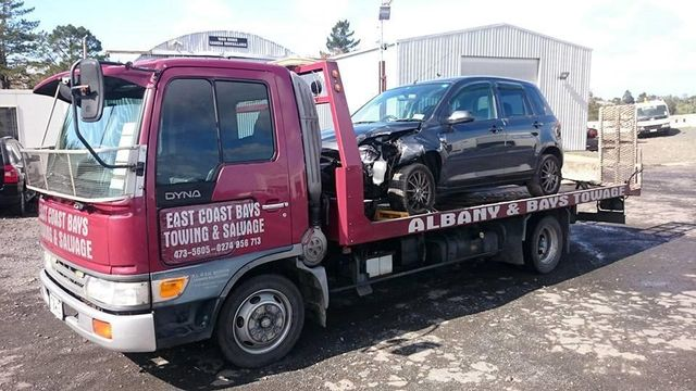 Professionals providing towing services during breakdown