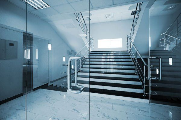 Glass doors with a marble staircase