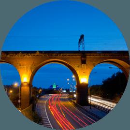 Railway bridge over a busy road