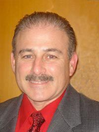 Dr. Perry Lerner, AuD, FAAA board certified in Audiology by the American Board of Audiology