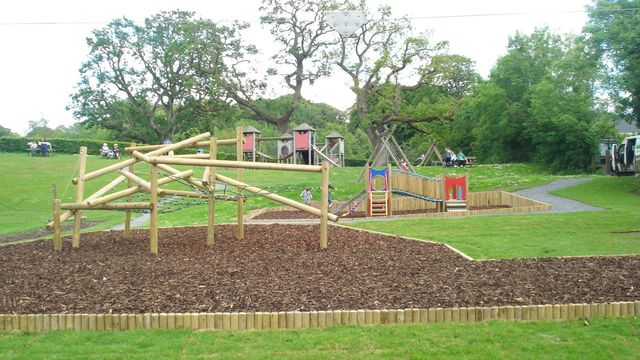 Wooden climbing frames on an area of play bark