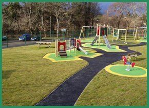 Swings and climbing frames on green and yellow circles