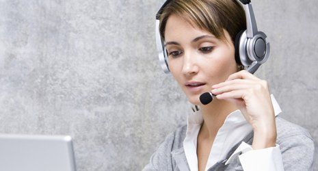 A lady with a headset on