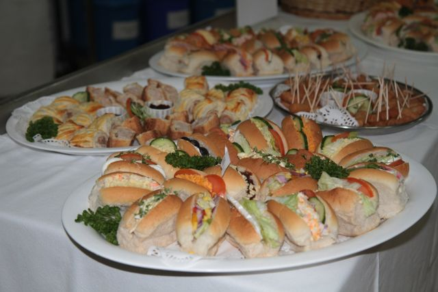 A cold buffet table with forks and red napkins
